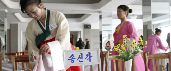 A North Korean waitress folds a napkin before the start of a cooking competition held at a noodle restaurant in Pyongyang, North Korea, on Thursday, Nov. 22, 2012. Cooks and servers from around North Korea took part in the three-day cooking competition. (AP Photo/Jon Chol Jin)